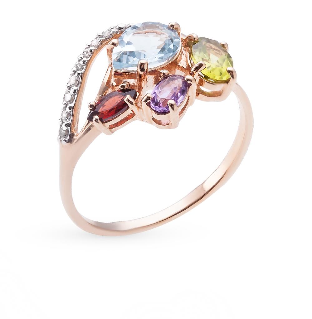 Фото «золотое кольцо с гранатами, топазами и фианитами»