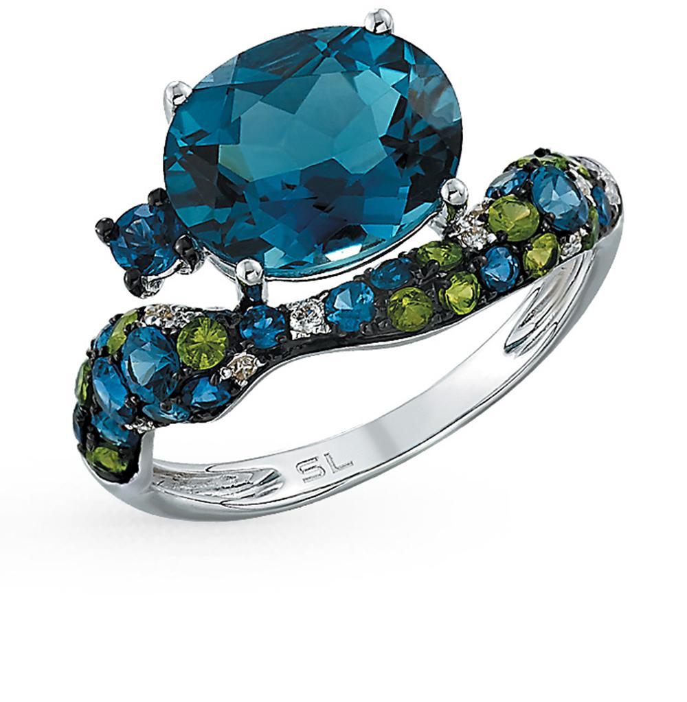 Фото «золотое кольцо с гранатами, топазами и сапфирами»