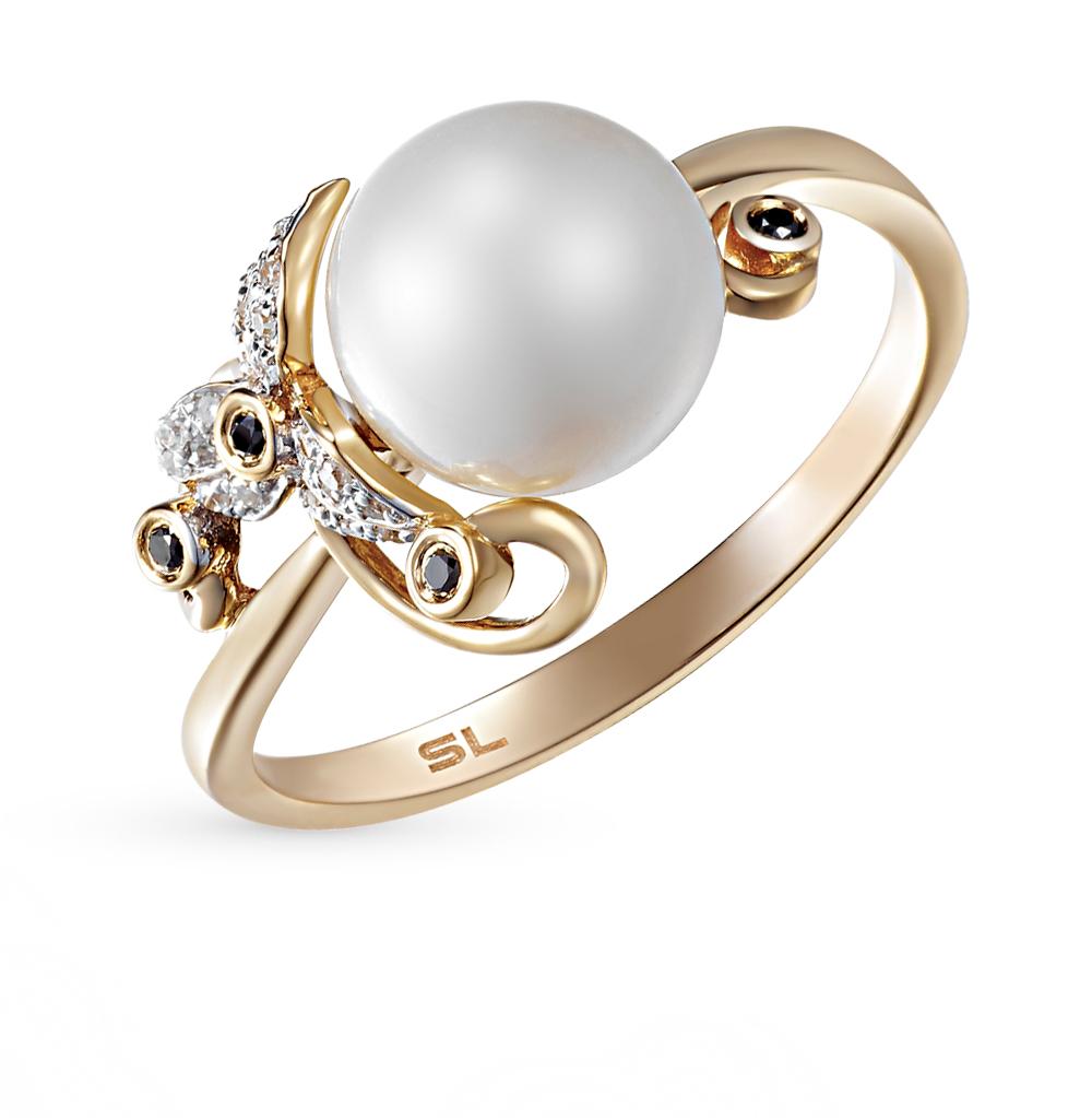 Фото «золотое кольцо с чёрными и белыми бриллиантами и жемчугом»